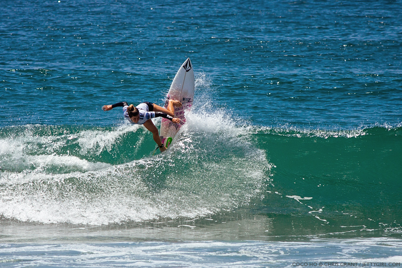 Always a contender, Coco Ho smacks the lip en route to the quarterfinals at the 2013 Supergirl Pro in Oceanside, California. Surf photo by Chris Grant, Jettygirl Online Surf Magazine.