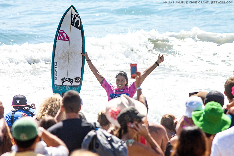 The moment of victory for Malia Manuel at the 2013 Supergirl Pro in Oceanside, California. Surf photo by Chris Grant, Jettygirl Online Surf Magazine.