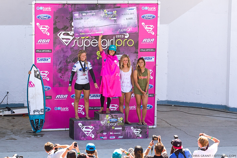 Malia Manuel collects the big check at the 2013 Supergirl Pro in Oceanside, California. Surf photo by Chris Grant, Jettygirl Online Surf Magazine.