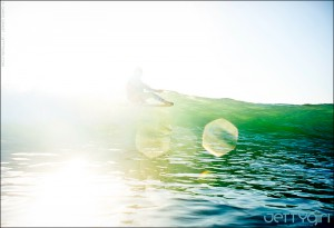 Kassia Meador in blinding light, surf photo by Chris Grant