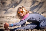 One of the keys to good surfing is flexibility. Courtney Conlogue stretches before paddling out.
