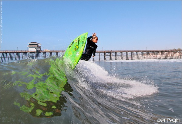Kim Mayer off the top at Oceanside Pier. Surf photo by Chris Grant, Jettygirl.com.