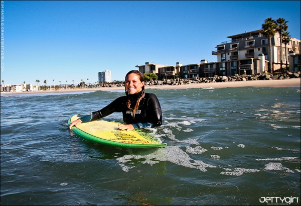 Santa Cruz surfer Kim Mayer with a smile that would light up any room. Photo by Chris Grant of Jettygirl Online Surf Magazine.