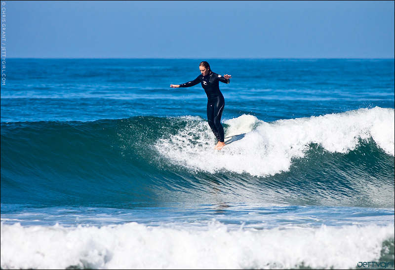 Cori Schumacher, Oceanside noseride. Surf photo by Chris Grant of JettyGirl.