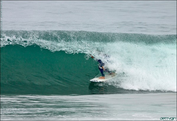 Claire Bevilacqua barreled in Newport Beach, surf photo by Chris Grant of JettyGirl Online Surf Magazine.