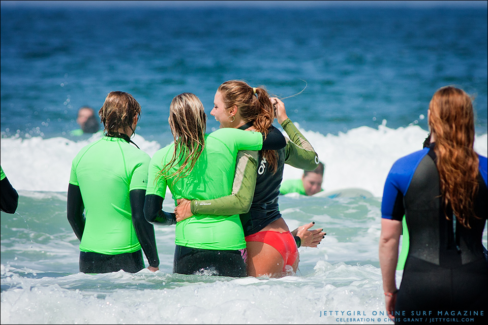 While Sophia rides a wave on the outside, Leila Hurst and Natalie McPeek cheer on the inside. Photo by Chris Grant, Jettygirl Online Surf Magazine.