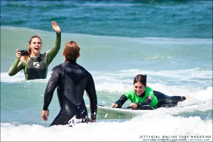 Natalie McPeek cheers for her lifelong friend, Sophia Hurst at Life Rolls On's They Will Surf Again event in La Jolla, California. Surf photo by Chris Grant, jettygirl.com
