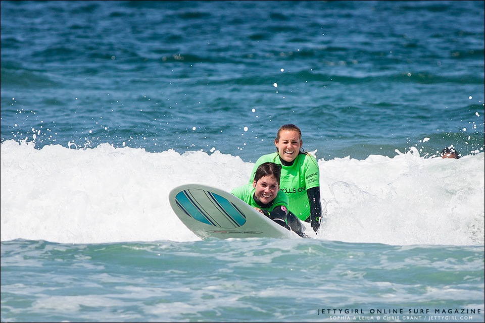 Leila Hurst and her sister, Sophia Hurst, ride a wave together with Life Rolls On. Surf photo by Chris Grant, Jettygirl Online Surf Magazine.