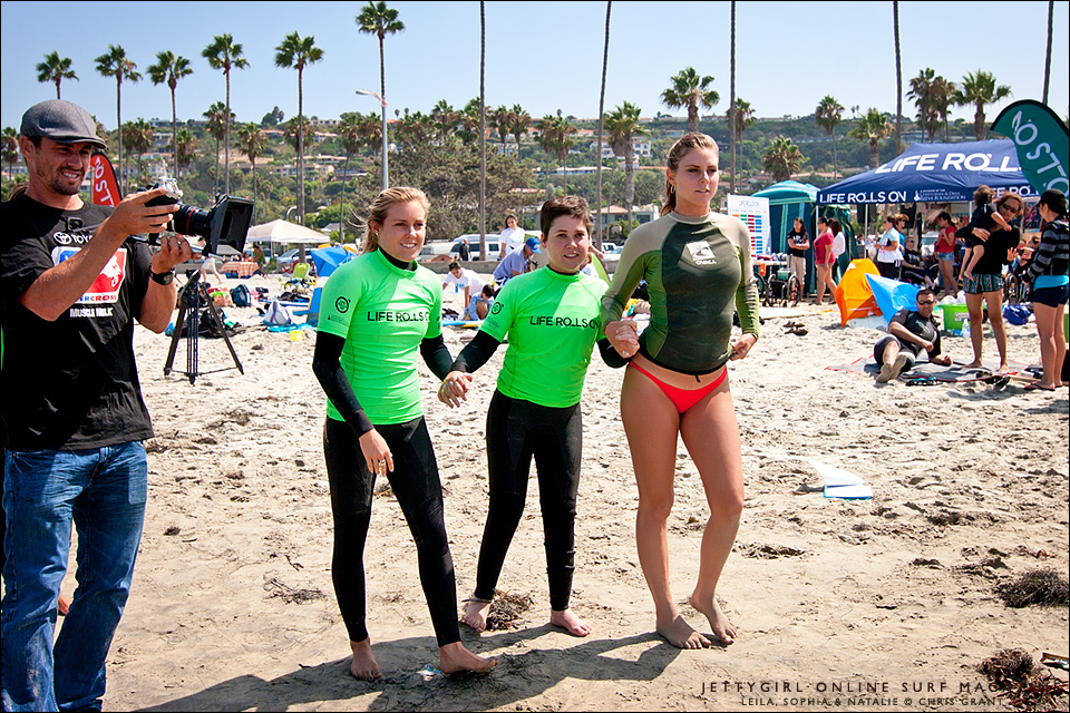Leila Hurst, Sophia Hurst and Natalie McPeek make their way to the water's edge. Photo by Chris Grant, Jettygirl Online Surf Magazine.