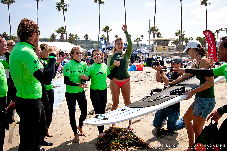 Surrounded by Life Rolls On volunteers, Sophia Hurst, all smiles and ready to go surfing. Photo by Chris Grant of Jettygirl Surf Magazine.