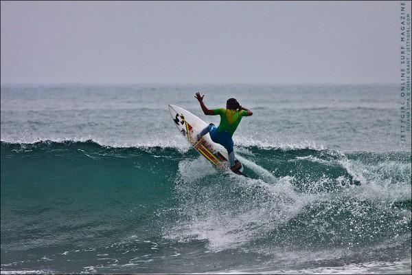 Silvana Lima punts a frontside double grab in California. Surfing photo by Chris Grant, Jettygirl Online Surf Magazine.