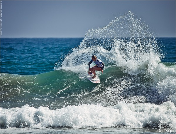 Current world champion, Carissa Moore, hucking spray in Huntington Beach. Surf photo © Chris Grant, Jettygirl.com