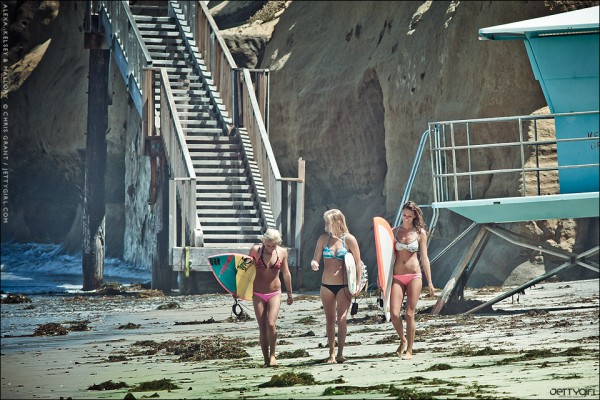 Alexa, Kelsey and Mallory walk up the beach after an exhausting session of non-stop paddling, currents and closeout sets. Photo by Chris Grant, Jettygirl.com.