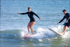 Lindsay and Ryan Engle sharing a wave at Doheny. Surf photo by Chris Grant - Jettygirl Online Surf Magazine.