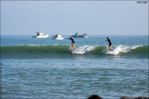 Lindsay and Ryan Engle sharing noserides at Doheny. Surf photo by Chris Grant - Jettygirl Online Surf Magazine.