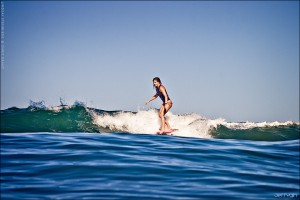 Lindsay Steinriede, San Onofre noseride. Surfboard by Ryan Engle. Surf photo by Chris Grant of Jettygirl.com