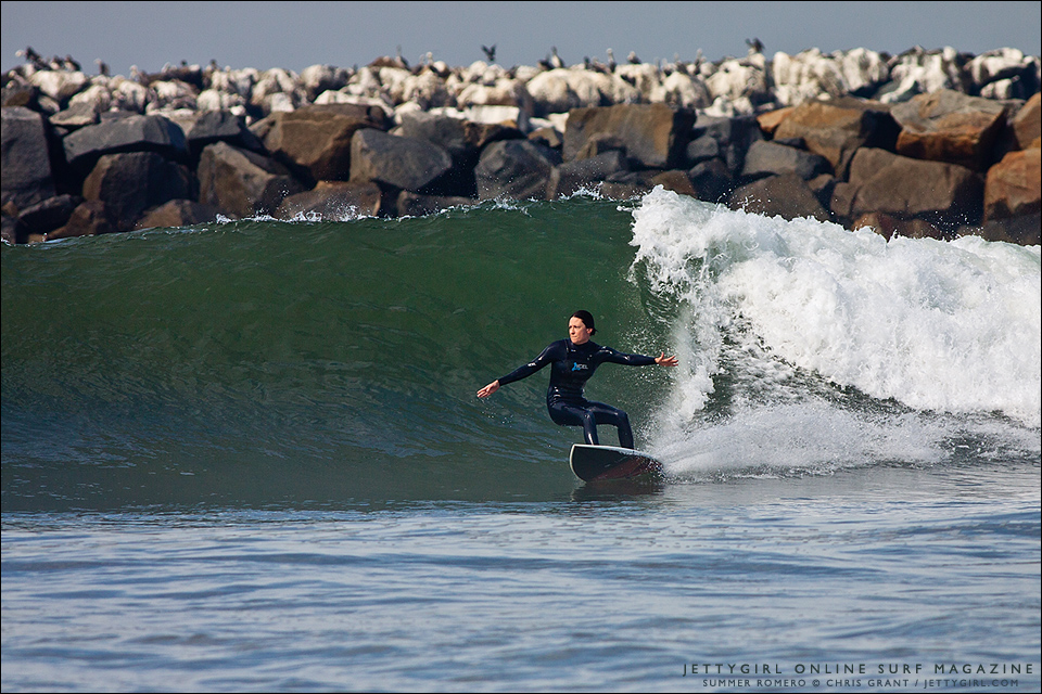 Summer Romero, 2004 World Longboard Champion, shreds on a shortboard in clean, California conditions. Surf photo by Chris Grant, Jettygirl Online Surf Magazine.