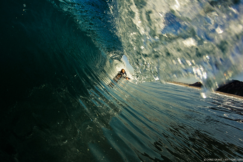 Kamalehua Keohokapu inside a clean barreling wave. Surf photo © Chris Grant, Jettygirl Online Surf Magazine.