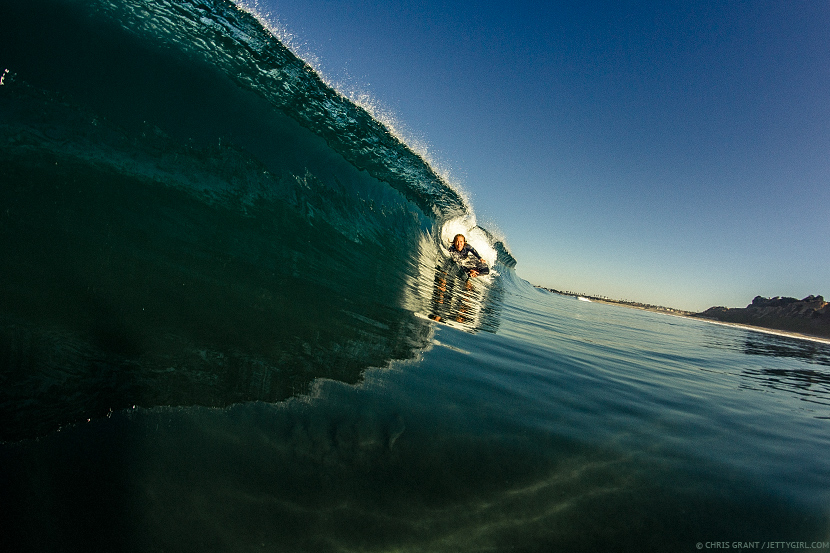 Dropping into a perfect glassy right with Kamalehua Keohokapu. Surf photo © Chris Grant, Jettygirl Online Surf Magazine.
