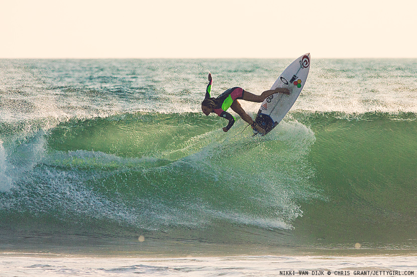 2014 ASP Women's World Tour member, Nikki Van Dijk, hooks one backside on a clean afternoon left. Surf photo by Chris Grant, Jettygirl Online Surf Magazine.