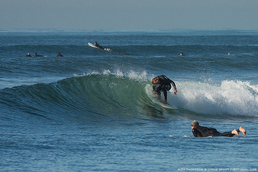 Alex Thompson, old-school style in the hook. Surf photo by Chris Grant, Jettygirl.com