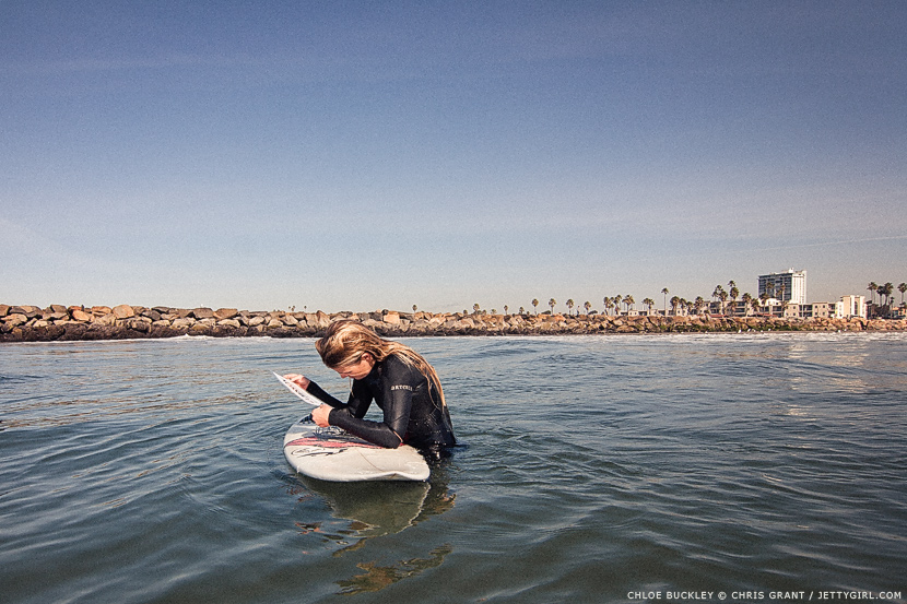 Chloe Buckley making sure our sign didn't spring a leak. Photo by Chris Grant, Jettygirl Online Surf Magazine.