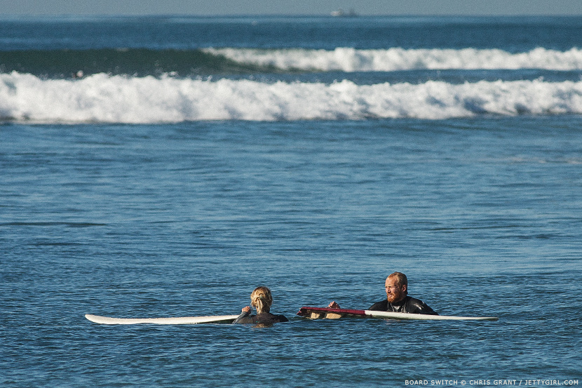 Chris Cuevas and Alex Thompson switch surfboards. Surf photo by Chris Grant, Jettygirl Online Surf Magazine.