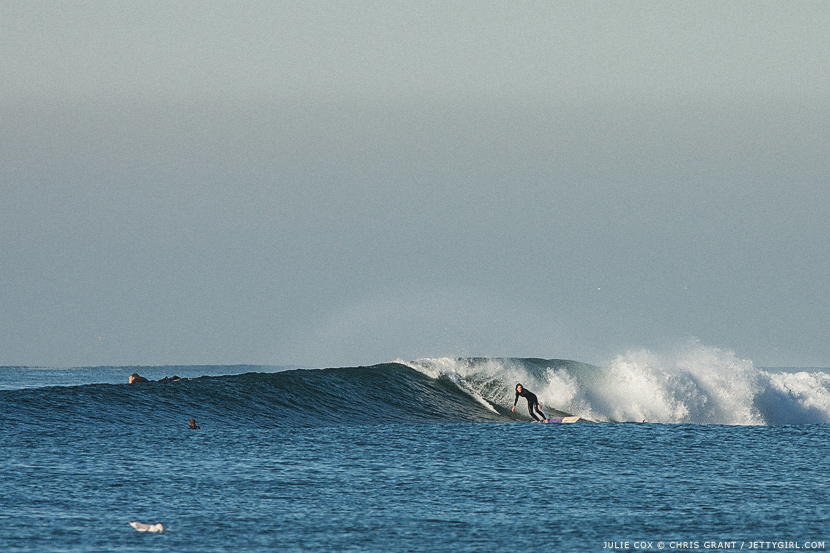 Julie Cox drops into a nice right. Surf photo by Chris Grant, Jettygirl Online Surf Magazine.