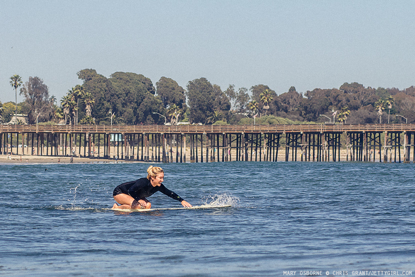 Mary Osborne knee paddling her Cooperfish surfboard in Ventura, California. Photo by Chris Grant, Jettygirl Online Surf Magazine.