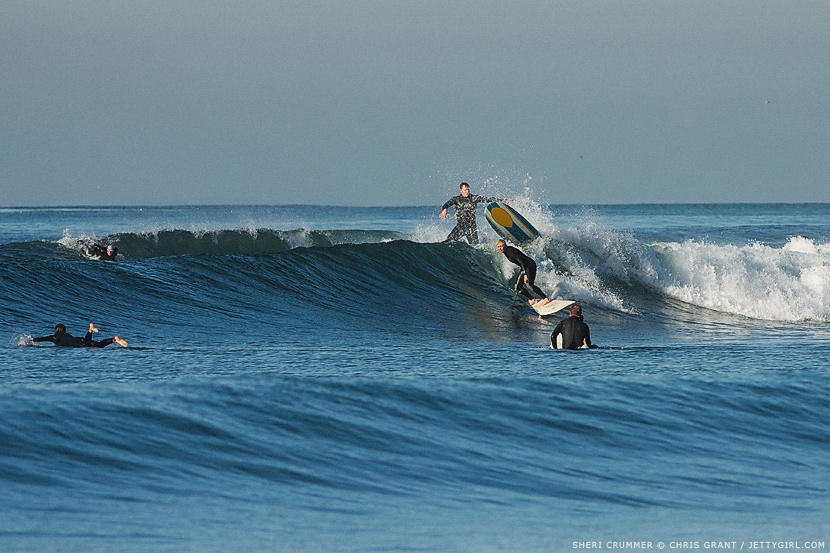 Sheri Crummer threads through the crowds. Surf photo by Chris Grant, Jettygirl Online Surf Magazine.