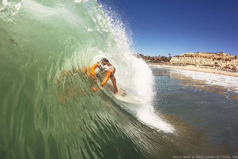 Malia Ward in a thick-lipped barrel. Surf photo by Chris Grant, Jettygirl Online Surf Magazine.