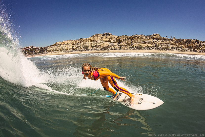 Malia Ward drives off the bottom on a sunny California day. Surf photo by Chris Grant, Jettygirl Online Surf Magazine.
