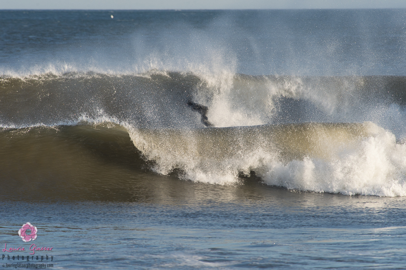 Casey Kwiecinski, stiff offshore winds courtesy of the recent polar vortex. Surf photo by Laurie Glasser Photography. K Twins on Jettygirl Online Surf Magazine.