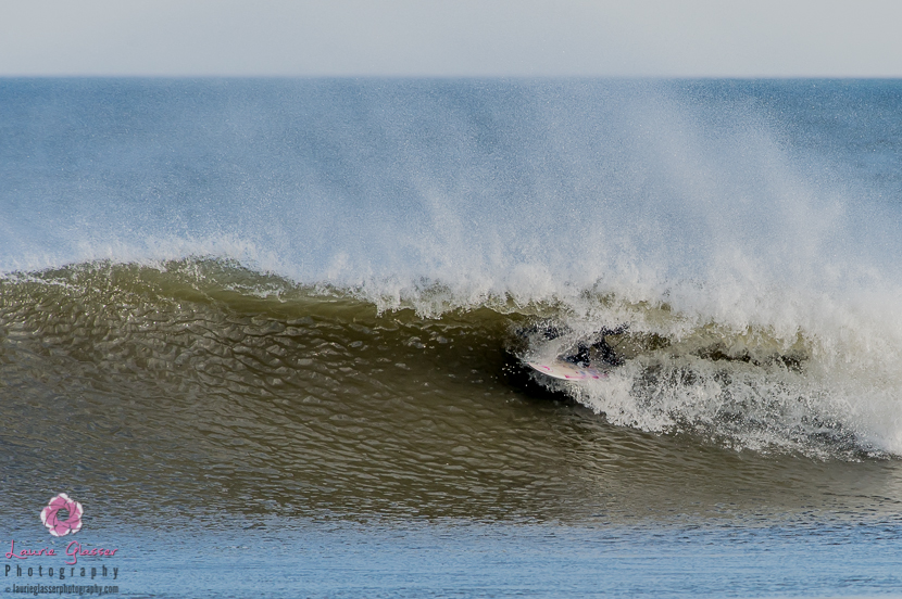 Casey Kwiecinski gets a clean New Jersey barrel courtesy of the January 2014's polar vortex. Surf photo by Laurie Glasser Photography. K Twins on Jettygirl Online Surf Magazine.