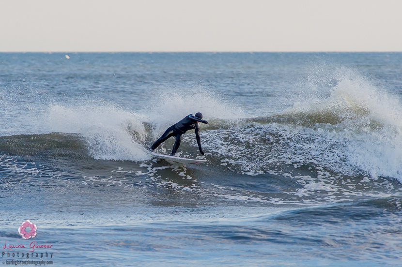 Casey Kwiecinski throwing water in New Jersey. Surf photo by Laurie Glasser Photography. K Twins on Jettygirl Online Surf Magazine.