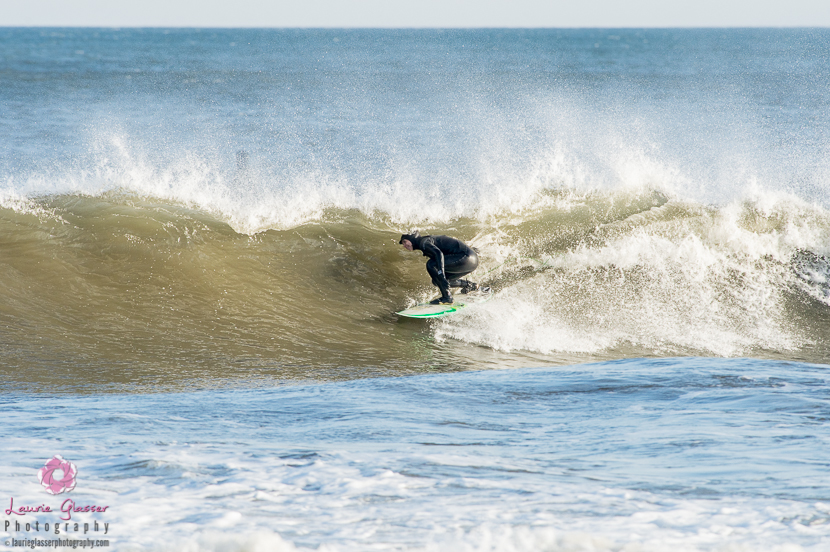 Jessica Kwiecinski pulls into a New Jersey barrel in freezing conditions during the polar vortex. Surf photo by Laurie Glasser Photography. K Twins on Jettygirl Online Surf Magazine.