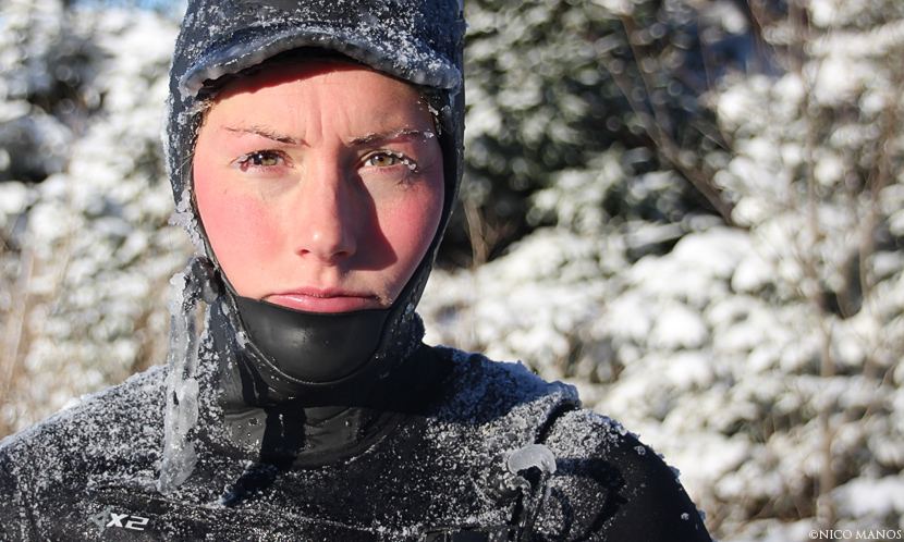 Jill Manos, Canada surfer covered in ice while wearing freezing wetsuit. Surf photo by Nico Manos.