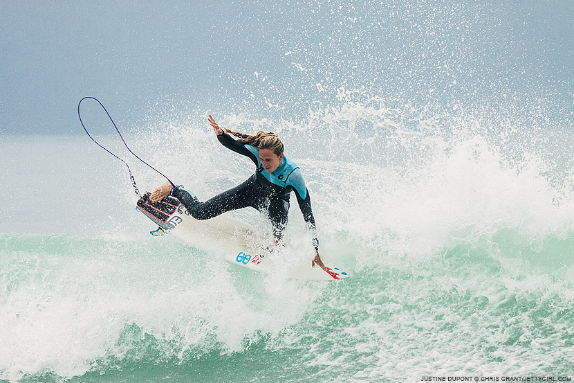 Justine Dupont throws her fins. Surf photo by Chris Grant, Jettygirl Online Surf Magazine.