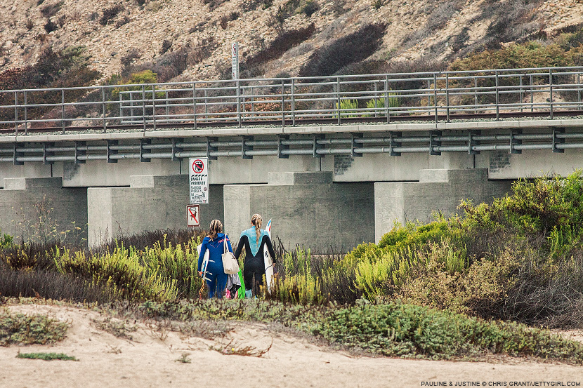 Pauline Ado and Justine Dupont leave the beach after their final surf session in California. Chris Grant photo on Jettygirl Online Surf Magazine.