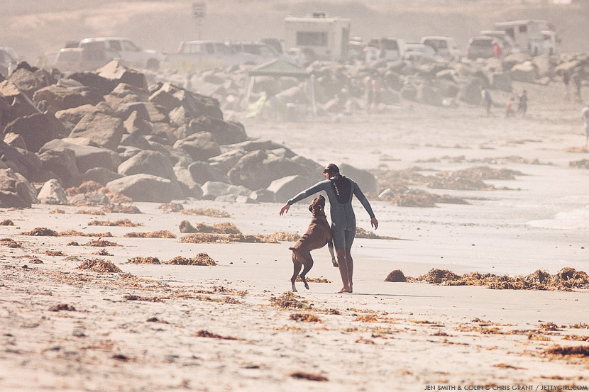 Jen Smith and her dog, Colin, go for a walk in Cardiff, California. Chris Grant photo on Jettygirl Online Surf Magazine.