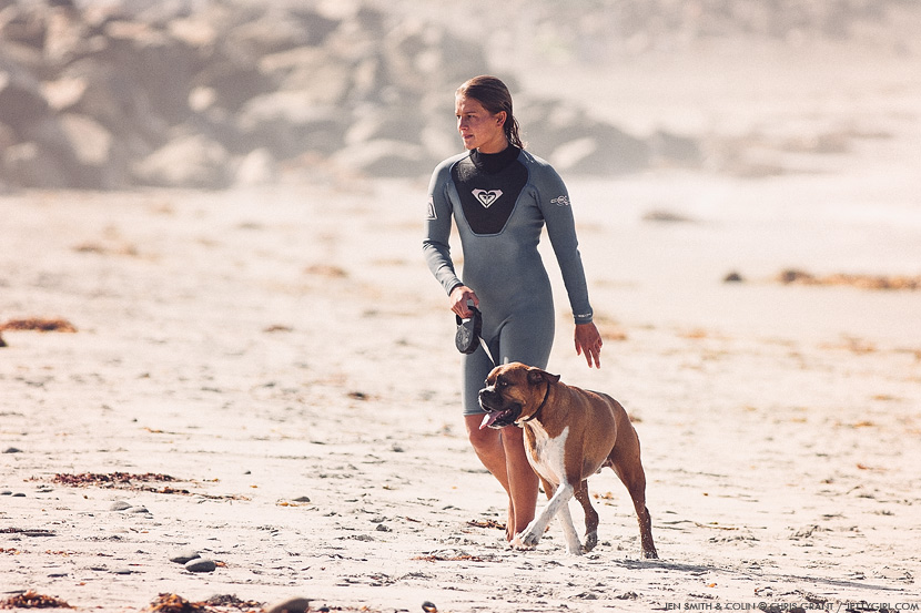 Jen Smith walks her dog, Colin, on the beach in Cardiff. Chris Grant photo on Jettygirl Online Surf Magazine.