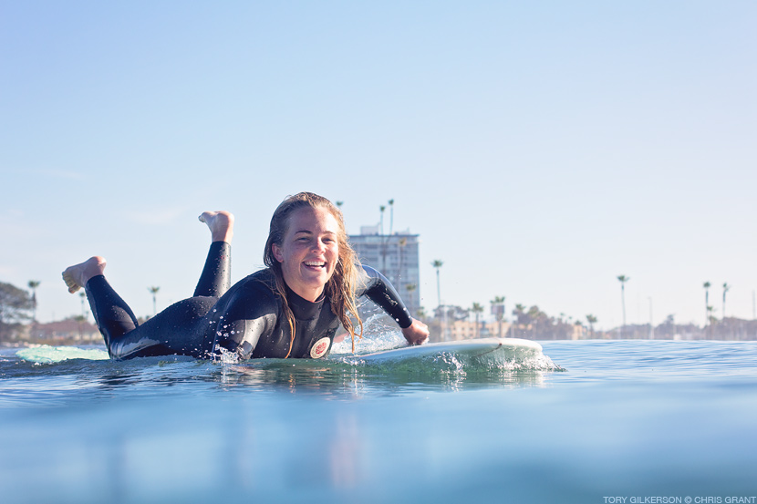 Tory Gilkerson is all smiles after a solid noseride at Oceanside Harbor. Chris Grant photo on Jettygirl Online Surf Magazine.
