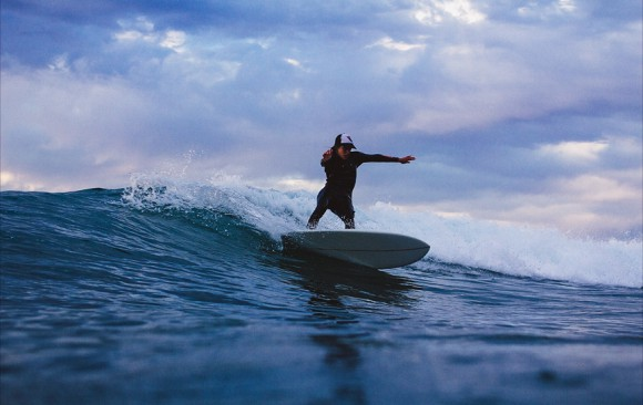 Christine Brailsford wraps a turn on her furrowsurfcraft surfboard. Chris Grant photo for Jettygirl Surf Magazine and Lifestyle Photo Blog