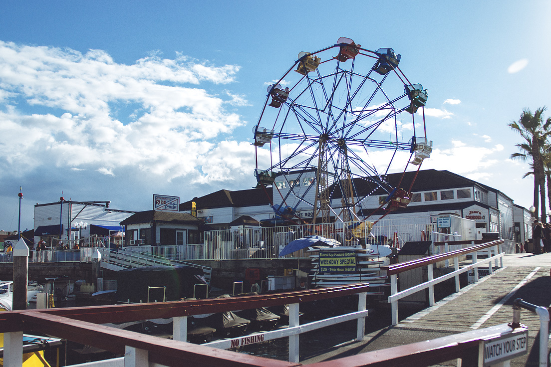 The world famous ferris wheel at the Balboa Fun Zone. Visit Newport Beach - Enriching in Every Sense. Photo by Chris Grant, JettyGirl Surf Magazine