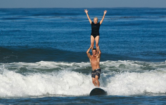 Linda Benson tandem surfing with Bobby Friedman in Cardiff, California, 2015. Photo: Chris Grant for JettyGirl Surf Mag.