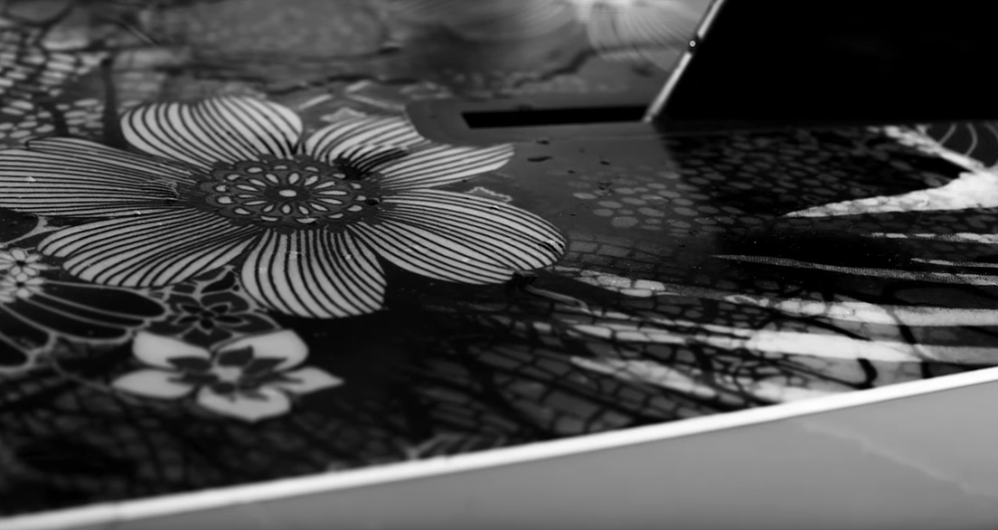 Floral inlay on Tia Blanco's self-shaped single fin longboard. Frame grab from Justin Jung's surf film,  A Short Escape, playing on Jettygirl Surf Magazine
