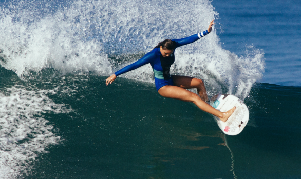 Cayla Moore slices a turn at Lowers. Chris Grant photo for Jettygirl Online Surf Magazine.
