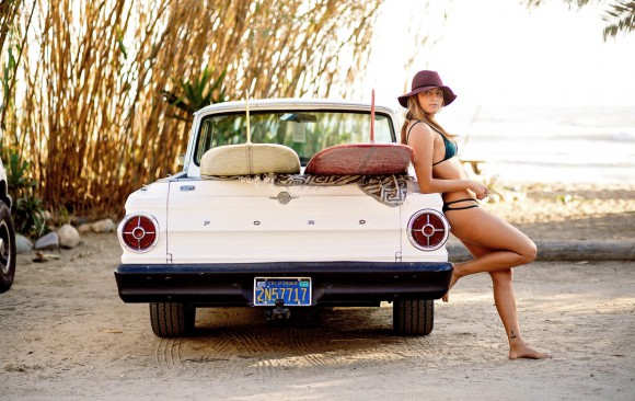 Kiana Fores relaxing against 1965 Ford Ranchero with two surfboards in the back - Chris Grant Photo