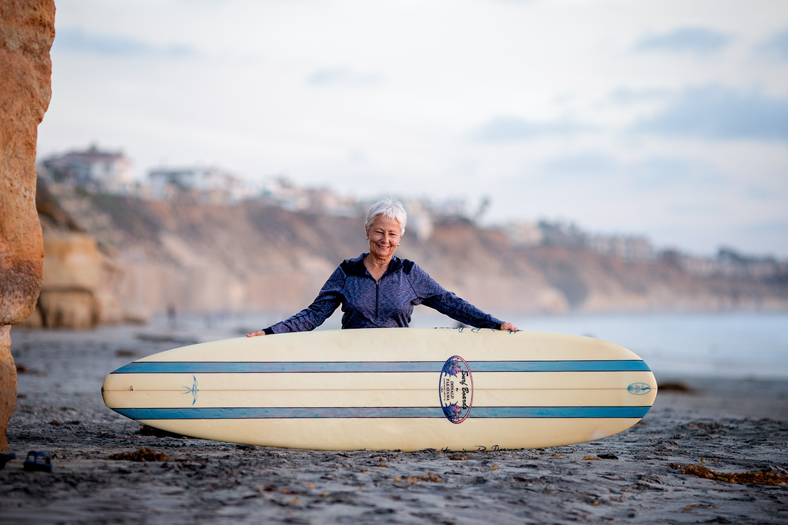 linda-benson-with-her-beloved-donald-takayama-surfboard-chris-grant-photo
