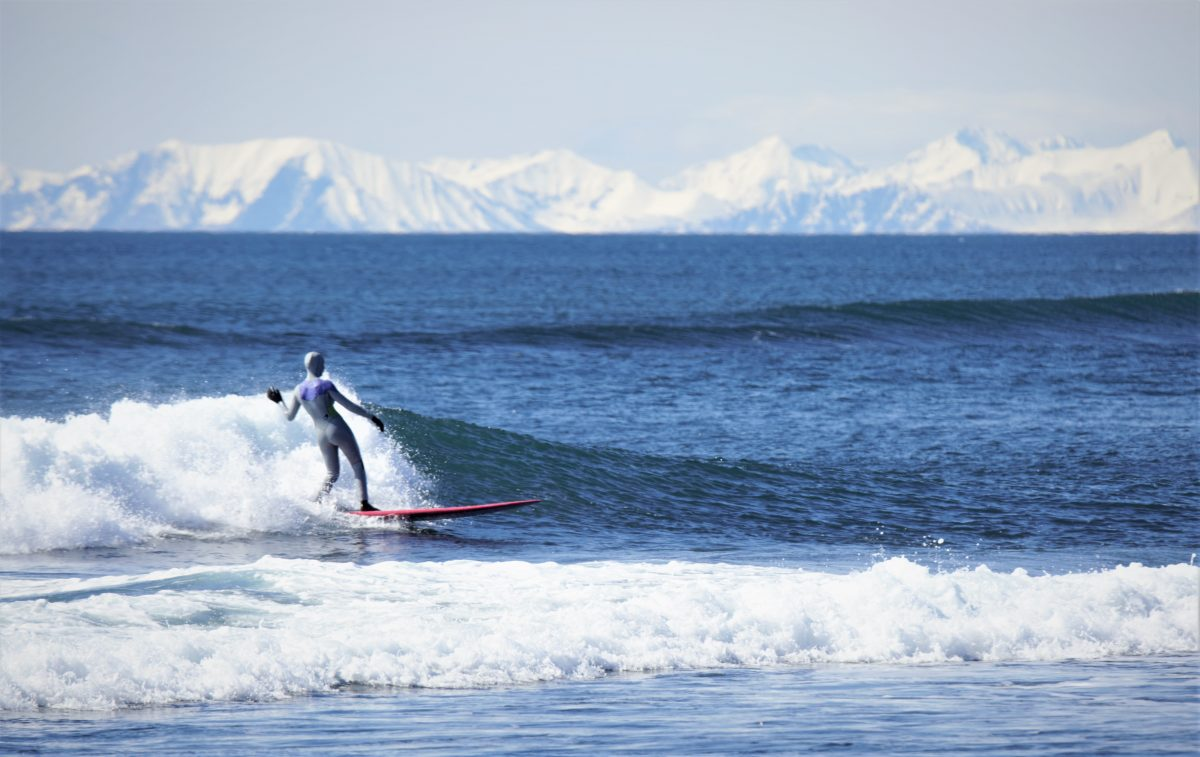 A beautiful day in Kamchatka surfing fun, freezing waves on my longboard - Photo: Gavrilova